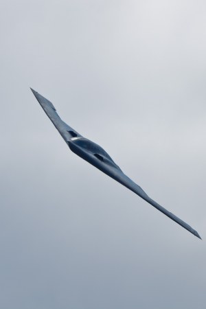 "TACOMA, WA – JULY 21: Northrop Grumman B-2A Spirit (""Spirit of Ohio"") flyby demonstration during Air Expo at McChord Field Joint Base Lewis-McChord on July 21, 2012 in Tacoma, WA.  Stock Photo - 14581507"