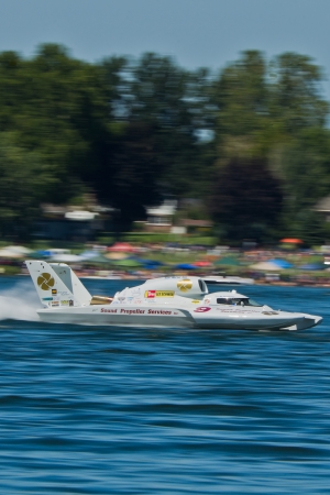 chasing tail: TRI-CITIES, WA - JULY 29: Jon Zimmerman pilots the U-9 Jones Racing unlimited hydroplane at the Lamb Weston Columbia Cup July 29, 2012 on the Columbia River in Tri-Cities, WA.