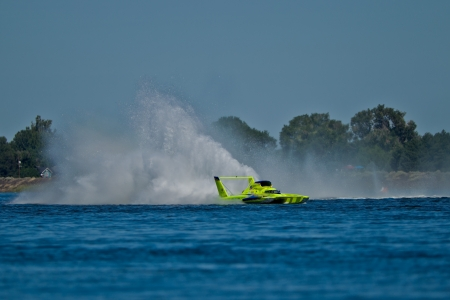 hydroplane: TRI-CITIES, WA - JULY 29: JW Myers pilots the U-11 Unlimited Racing Group hydroplane creating the wall of water called a roostertail at the Lamb Weston Columbia Cup July 29, 2012 on the Columbia River in Tri-Cities, WA. Editorial