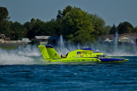 chasing tail: TRI-CITIES, WA - JULY 29: JW Myers pilots the U-11 Unlimited Racing Group hydroplane at the Lamb Weston Columbia Cup July 29, 2012 on the Columbia River in Tri-Cities, WA.