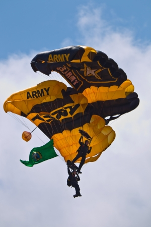 tacoma: TACOMA, WA - JULY 21: The US Army Golden Knights Parachute Team demonstrate tandem parachuting during Air Expo at McChord Field Joint Base Lewis-McChord on July 21, 2012 in Tacoma, WA. Editorial