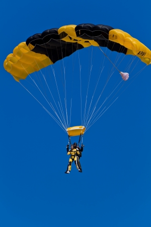 HILLSBORO, OR -  AUG 4: Tandem skydiving with a member of the US Army Golden Knights Parachute Team at the Oregon Air Show at Hillsboro Airport on August 4, 2012 in Hillsboro, OR.