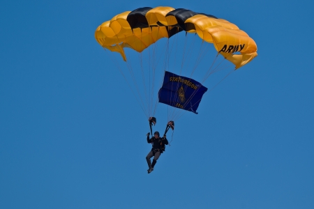 HILLSBORO, OR: AUG 5: A member of the US Army Golden Knights Parachute Team performs at the Oregon Air Show at Hillsboro Airport on August 5, 2012 in Hillsboro, OR.  Stock Photo - 14739984