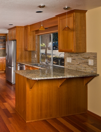 traditional custom: Renovated designer kitchen. Stock Photo