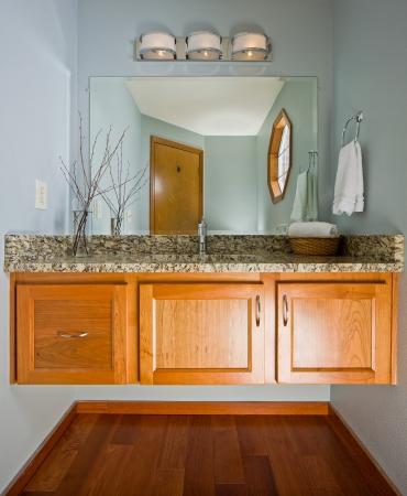 custom cabinet: Renovated designer .5 bath with floating cabinet.