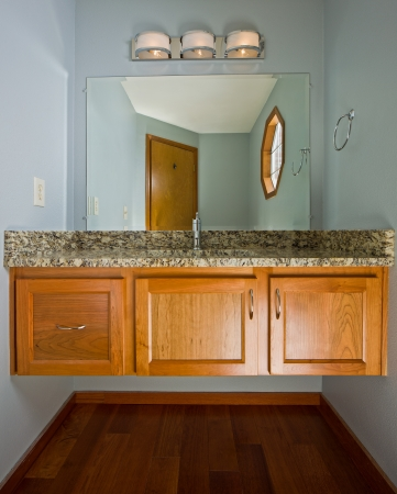 custom cabinet: Renovated designer .5 bath with floating cabinet.