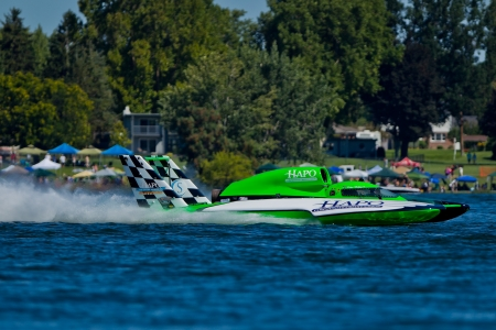 turn left: TRI-CITIES, WA - JULY 29: Brian Perkins pilots U-21 Go Fast, Turn Left hydroplane along the water at the Lamb Weston Columbia Cup July 29, 2012 on the Columbia River in Tri-Cities, WA.  Editorial