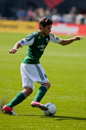 rivals rival rivalry season: PORTLAND, OR - SEPT 15: The Portland Timbers midfielder Sal Zizzo #7 moves the ball during Seattle Sounders vs. Portland Timbers game, on Sep 15, 2012 at Jeld-Wen Field in Portland, OR.