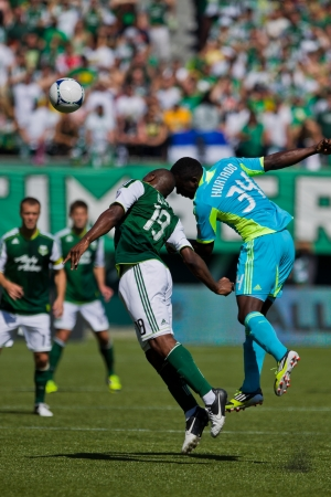 PORTLAND, OR - SEPT 15: Bright Dike #19 of the Portland Timbers battles for a ball with Jhon Kennedy Hurtado #34 of the Seattle Sounders during the game, on Sep 15, 2012 at Jeld-Wen Field in Portland, OR.