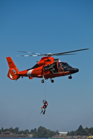 TRI-CITIES, WA - JULY 28: USCG Eurocopter HH-65C Dolphin Helicopter Rescue Demonstration Flight at the Lamb Weston Columbia Cup July 28, 2012 on the Columbia River in Tri-Cities, WA.
