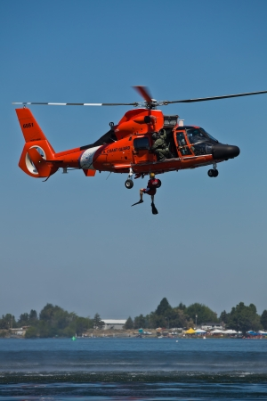 TRI-CITIES, WA - JULY 28: USCG Eurocopter HH-65C Dolphin Helicopter Rescue Demonstration Flight at the Lamb Weston Columbia Cup July 28, 2012 on the Columbia River in Tri-Cities, WA.  Stock Photo - 16507100