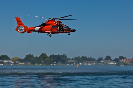 TRI-CITIES, WA - JULY 28: USCG Eurocopter HH-65C Dolphin Helicopter Rescue Demonstration Flight at the Lamb Weston Columbia Cup July 28, 2012 on the Columbia River in Tri-Cities, WA.  Stock Photo - 16507084