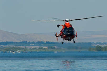 TRI-CITIES, WA - JULY 29: USCG Eurocopter HH-65C Dolphin Helicopter Rescue Demonstration Flight at the Lamb Weston Columbia Cup July 29, 2012 on the Columbia River in Tri-Cities, WA.  Stock Photo - 16507075