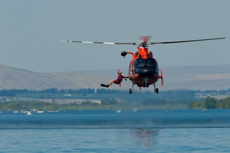 TRI-CITIES, WA - JULY 29: USCG Eurocopter HH-65C Dolphin Helicopter Rescue Demonstration Flight at the Lamb Weston Columbia Cup July 29, 2012 on the Columbia River in Tri-Cities, WA.  Stock Photo - 16507080
