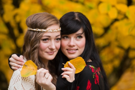 Beautiful elegant young women and autumn colors    photo