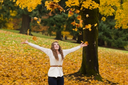 Beautiful elegant young woman and autumn colors. photo