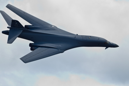 sequester: TACOMA, WA - JULY 21: B-1B Lancer flyby demonstration during Air Expo at McChord Field Joint Base Lewis-McChord on July 21, 2012 in Tacoma, WA.