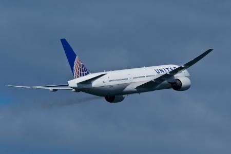 twin engine: SAN FRANCISCO, CA - OCTOBER 5:  United Airlines Boeing 777 (N212UA) demonstration during Fleet Week in San Francisco, CA on October 5, 2012.