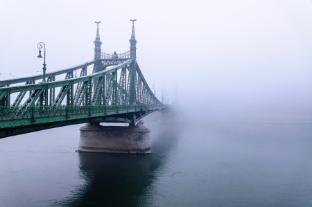 lamp made of stone: Bridge in Budapest in fog