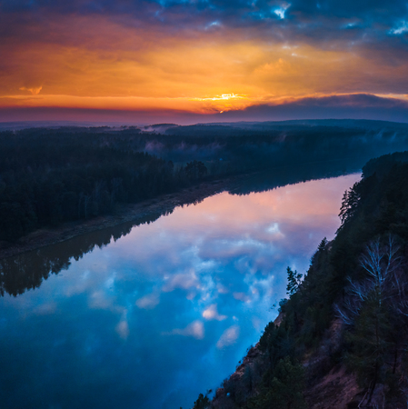 Aerial sunrise or sunset with colorful fog and river, square shot