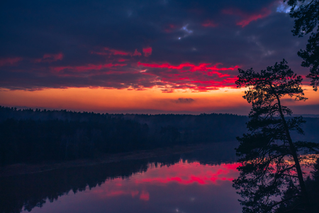 Aerial sunrise or sunset with colorful deep red sky