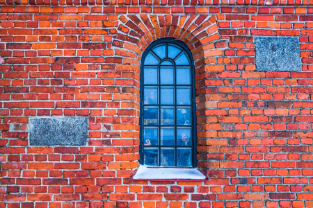 Old red brick wall texture background image with window inside