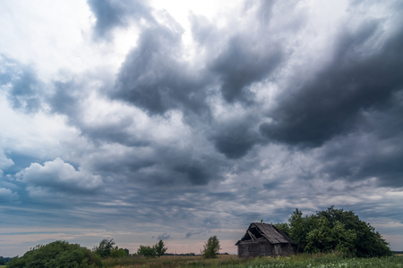 Image of dark Storm clouds above the house in Lithuania