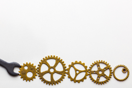 Top closeup view of gear wheels collection on white background with blank space for text. Top view, flat lay.