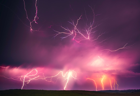 Lightning with dramatic clouds composite image . Night thunder-storm