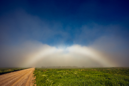 Rare White Rainbow Fogbow near the path
