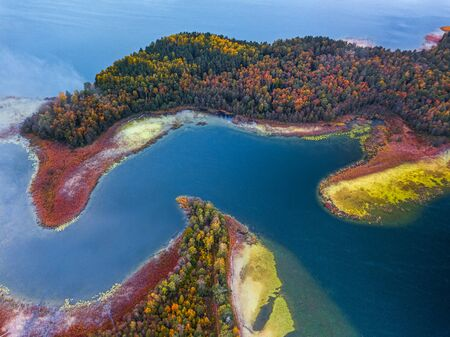 Aerial view over the lake with capes and bendings, Lithuania