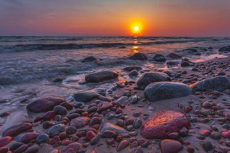 Baltic sea at beautiful sunrise light in Lithuania beach.
