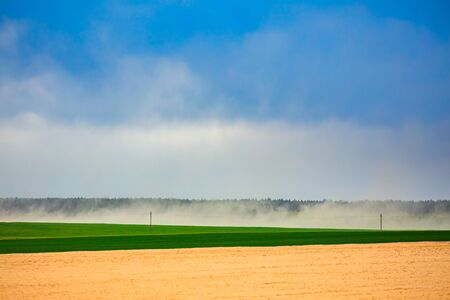 Dust storm in dry fields, dry weather infuenced by climate change