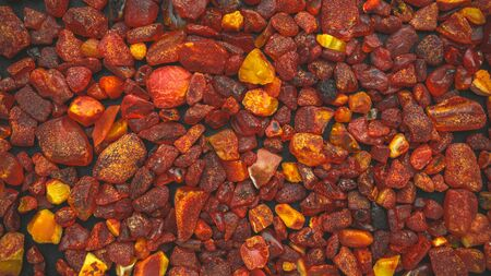 Amber stones natural background pattern, flat lay Reklamní fotografie