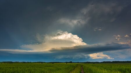 Supercell storm clouds with wall cloud and intense rain Reklamní fotografie