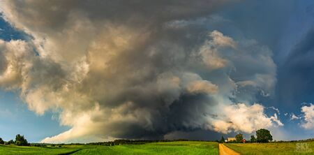 Severe supercell storm clouds with wall cloud and intense rain