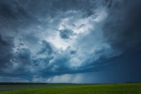 Supercell storm clouds with intense tropic rain Archivio Fotografico