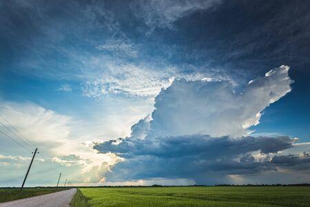 Cumulonimbus storm clouds in evening light with sun rays Reklamní fotografie