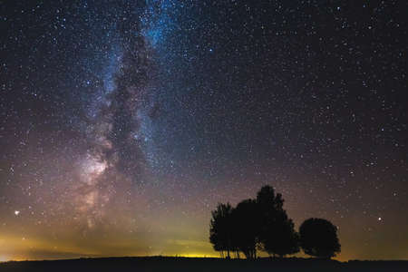 Landscape with Milky way galaxy glowing in the night sky