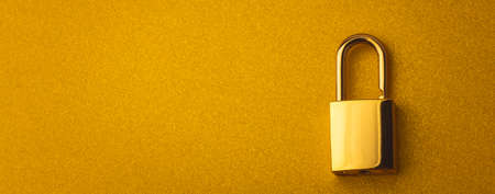 Golden lock on a golden background with empty space for text