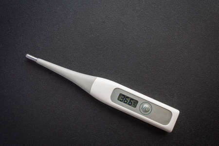 Picture of a thermometer on a dark background