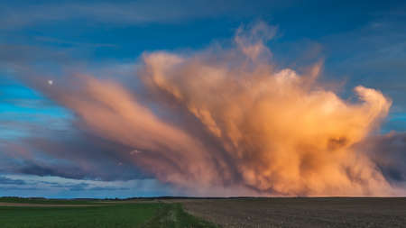 Mammatus clouds at sunset, dramatic storm clouds with moon