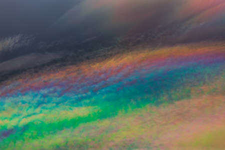 A rare sight: iridescent clouds. Diffraction can make clouds shine with colours like a corona.