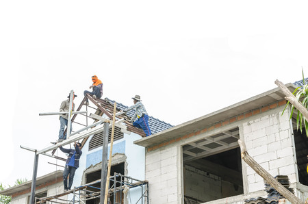 modular home: Worker repair roof with white background
