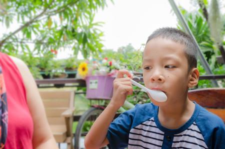 Little boy enjoy for eating
