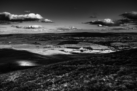 Scenic view from Pendle Hill, East, Clouds cast shadows over Lancashire Hills. Black and white. Forest Of Bowland. West Pennine Moors. Lancashire. England, UK