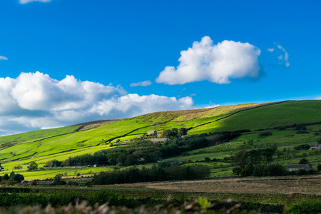 Farms from distance on English countryside, Forest Of Bowland, Enlgand UK