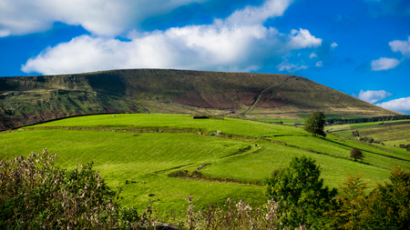 Z-shape uphill farm road, Pendle hill In distance, Forest Of Bowland, Lancashire, England UK