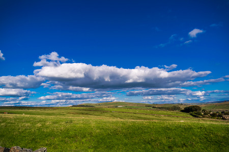 Clouds Formation over a farm, Forest Of Bowland, Lancashire, England UK Stock Photo