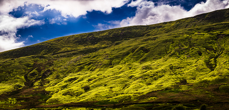 Slope of Pendle Hill with sky and clouds, Springtime in Forest of Bowland, Lancashire, England UK